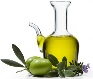 A bottle of olive oil with two olives and spices on white background